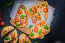 Flatbread Pizza Made With Naan Bread, Tomato Sauce, Mozzarella Cheese, Tomato And Basil