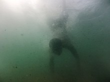 View Of A Man Swimming Underwater