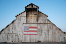 Old Barn At Dusk With American...