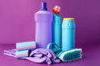 Leinwanddruck Bild - Set of cleaning supplies on color background