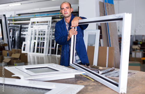 Portrait of worker assembler of plastic windows Canvas Print