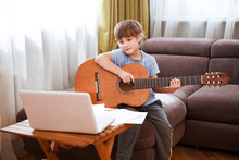 Kid  Boy Playing  Guitar And W...