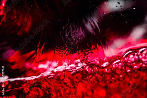 Fotografie, Obraz Red wine on black background.