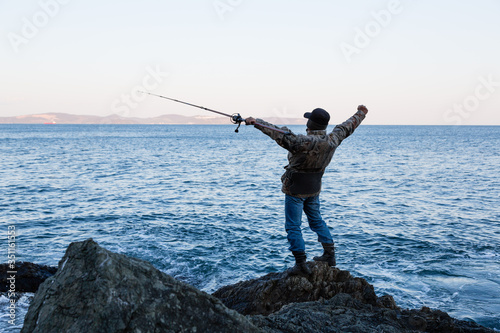 Fotomural Fisherman meditates before fishing