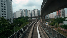 Driverless LRT Train On Elevated Tracks In City Of Singapore