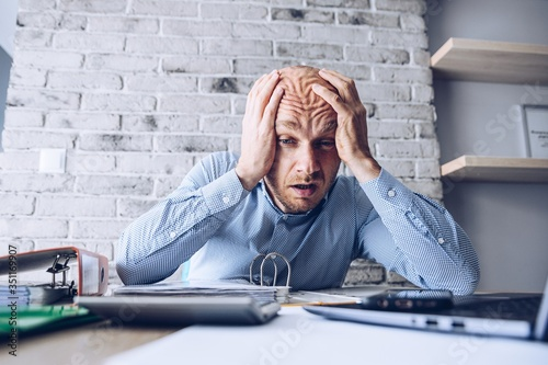 Fotografía Crying businessman stressed about bankruptcy debt.