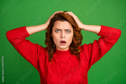 Obraz Portrait of astonished frustrated woman hear horrible work mistake novelty impressed scream omg touch hands redhead wear knitted pullover isolated over vivid color background - fototapety do salonu