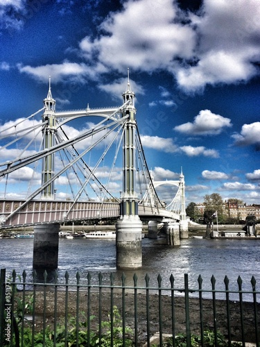 Albert Bridge Over Thames River Against Sky Canvas Print
