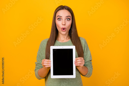 Portrait of astonished girl hold ebook impressed by modern technology advert pro Tapéta, Fotótapéta