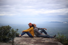 Women And Men Sit And Pour The Cliffs At The Mor Hin Khao National Park In Chaiyaphum, Thailand.