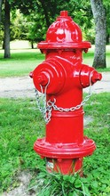 Close-up Of Fire Hydrant On Gr...