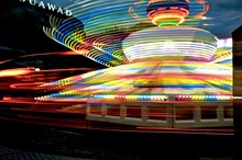 Colorful Light Trail Of Carousel At Night