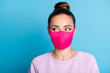 Portrait photo of pretty lady keep social distance citizen look side empty space see handsome guy sympathizing flirting wear protect bright face mask sweater isolated blue color background