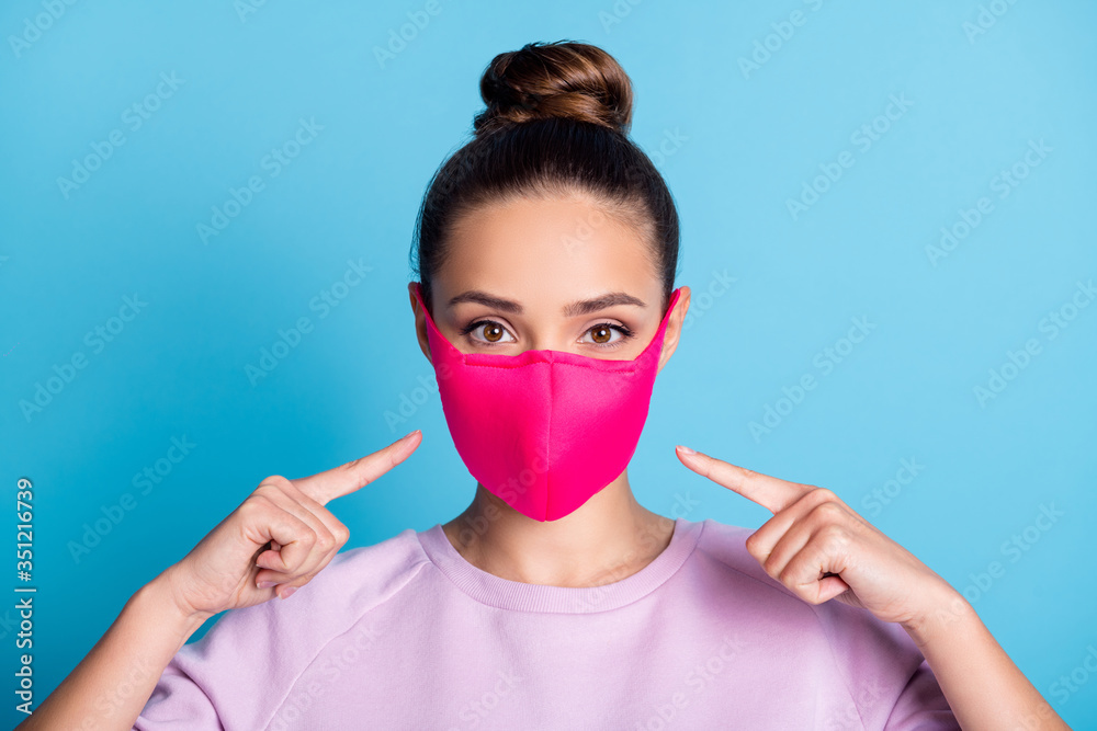 Fototapeta Photo of attractive lady keep social distance ignoring people contacting use respirator direct fingers safe face wear protect facial mask stylish sweater isolated blue color background