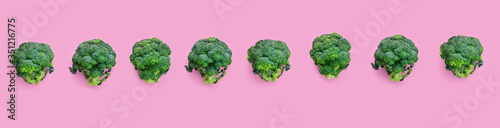 Fototapeta Fresh green broccoli on pink background obraz
