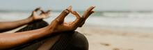 Black Woman Meditating On The Beach