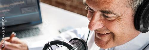Valokuvatapetti Aged broadcaster lives in a studio