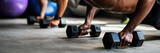 Sportive people using dumbbells