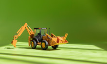 Toy Excavator. Model Of A Whee...