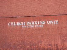 Church Only Parking Sign On Brick Wall.