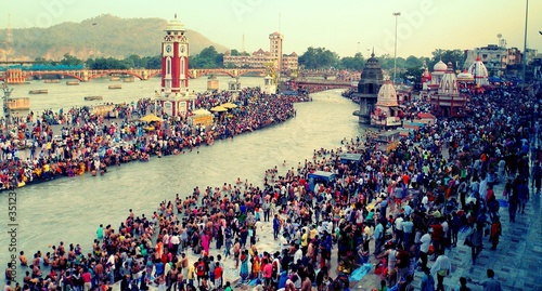 Fotografie, Obraz High Angle View Of People At Ganges River Taking Ritual Bath