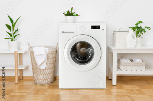 Obraz Rustic interior of home laundry room with modern washing machine - fototapety do salonu