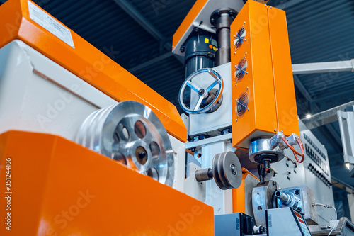 Obraz Modern industrial plant. Automotive machine equipment parts close up - fototapety do salonu