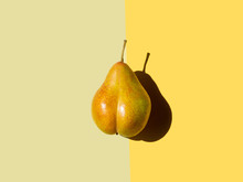 Bottom Shaped Pear On Yellow And Olive Background. Top View, Space For Text