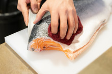 Color Image; Sushi; Table; Blue; Chef; Close-up; Cutting; Day; Fillet; Fish; Food; Food And Drink; Freshness; Healthy Eating; Horizontal; Human Body Part; Human Hand; Indoors; Japanese Food; Kitchen K