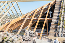 Renovation Projects. Building Of Extension Of The Existing House, Unfinished Wooden Roof Structure, Selective Focus
