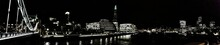 Panoramic View Of Shard London Bridge By Thames River Against Sky In City At Night