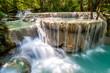 Waterfall and blue emerald water color in Erawan national park. Erawan Waterfall tier, Beautiful nature rock waterfall steps in tropical rainforest at Kanchanaburi province, Thailand