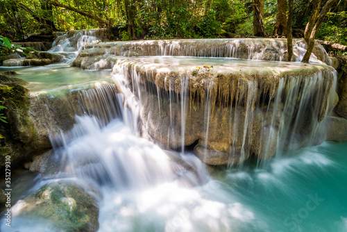 Fototapety, obrazy: Waterfall and blue emerald water color in Erawan national park. Erawan Waterfall tier, Beautiful nature rock waterfall steps in tropical rainforest at Kanchanaburi province, Thailand