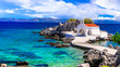 canvas print picture - Authentic traditional Greek islands- unspoiled Chios, View  of little church in the sea over the rocks , Agios Isidoros