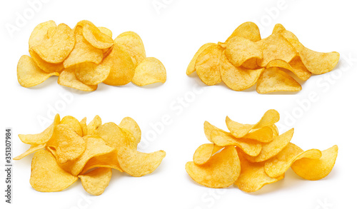 Fotografía Collection of delicious potato chips piles, isolated on white background