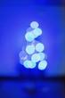 Leinwanddruck Bild - Defocused Image Of Illuminated Lights Against Blue Sky At Night