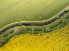 Aerial View Of Two Cultivation Fields Splitted By An Irrigation Canal, Po Valley, Lombardy, Italy.