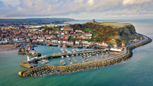Aerial View Of Scarborough Harbour With Lighthouse And Castle, UK