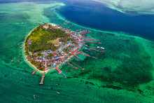 Aerial View Of The Tropical Island Derawan, Borneo, Indonesia. This Island Serves Se As The Main Village For Many Local Fishermen Families As Well As The Diving Base Camp For Tourists.