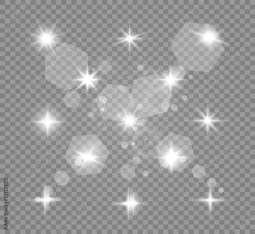 Fototapeta Set of gold bright beautiful stars. Light effect Bright Star. Beautiful light for illustration. Christmas star. Vector sparkles on transparent background.White glowing light. obraz na płótnie