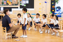 Foreign Teacher Teaching Child...