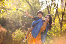 Happy Mother And Son Playing I...