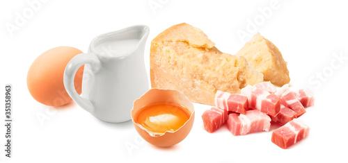 Fototapeta Ingredients for pasta carbonara sauce. Sliced bacon, cream, egg yolk and parmesan cheese isolated on white background obraz