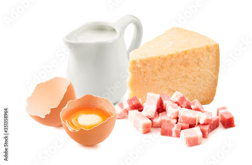Fototapeta Ingredients for pasta carbonara sauce. Italian bacon, cream, egg yolk and parmesan cheese isolated on white background obraz