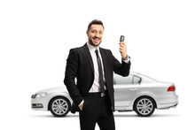 Man In A Suit Showing Car Keys And And Standing In Front Of A Silver Car