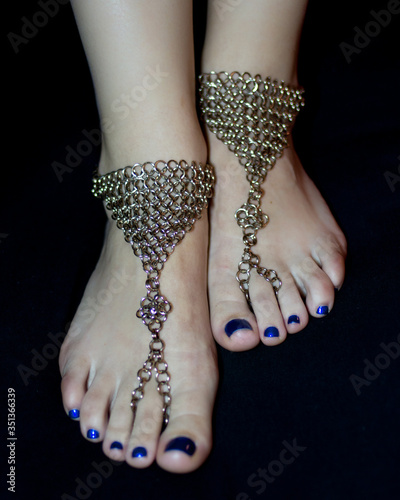Photo Low Section Of Woman With Painted Toenails Wearing Anklet Over Black Background