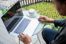 High Angle View Of Businessman Using Laptop Outdoors
