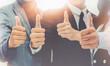 Leinwandbild Motiv Midsection Of Business People Showing Thumbs Up