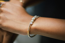 Cropped Hands Of Woman Wearing Bangle