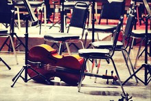 Cello And Empty Chairs In Conc...